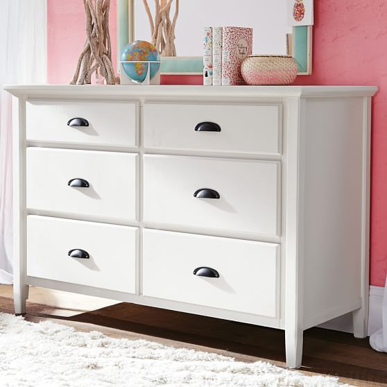 Bedroom with a white chest drawer