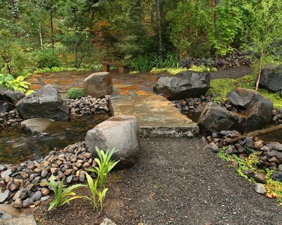 Garden with a simple stone bridge