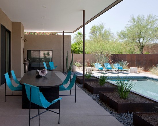 Porch with turquoise chairs