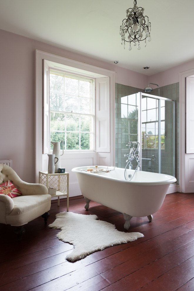 Big bathtub is placed on the wooden flooring