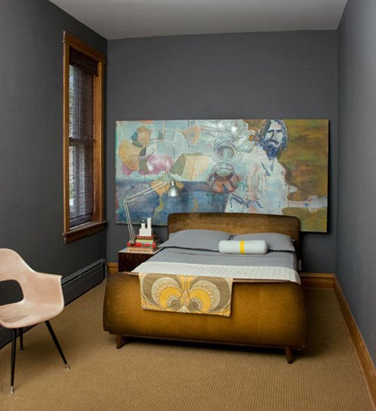 Bedroom with a big art work