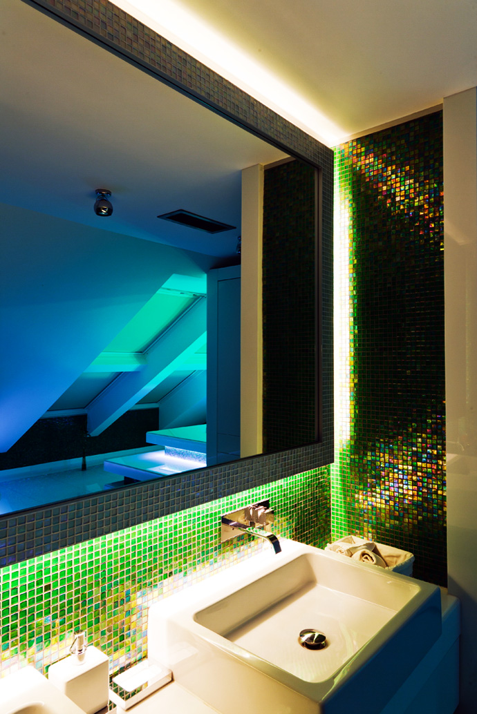 Blue light and green granite lift up the mood of the washbasin