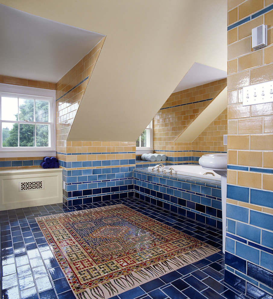 Bathroom with sandy golden and ocean themed blue tiles