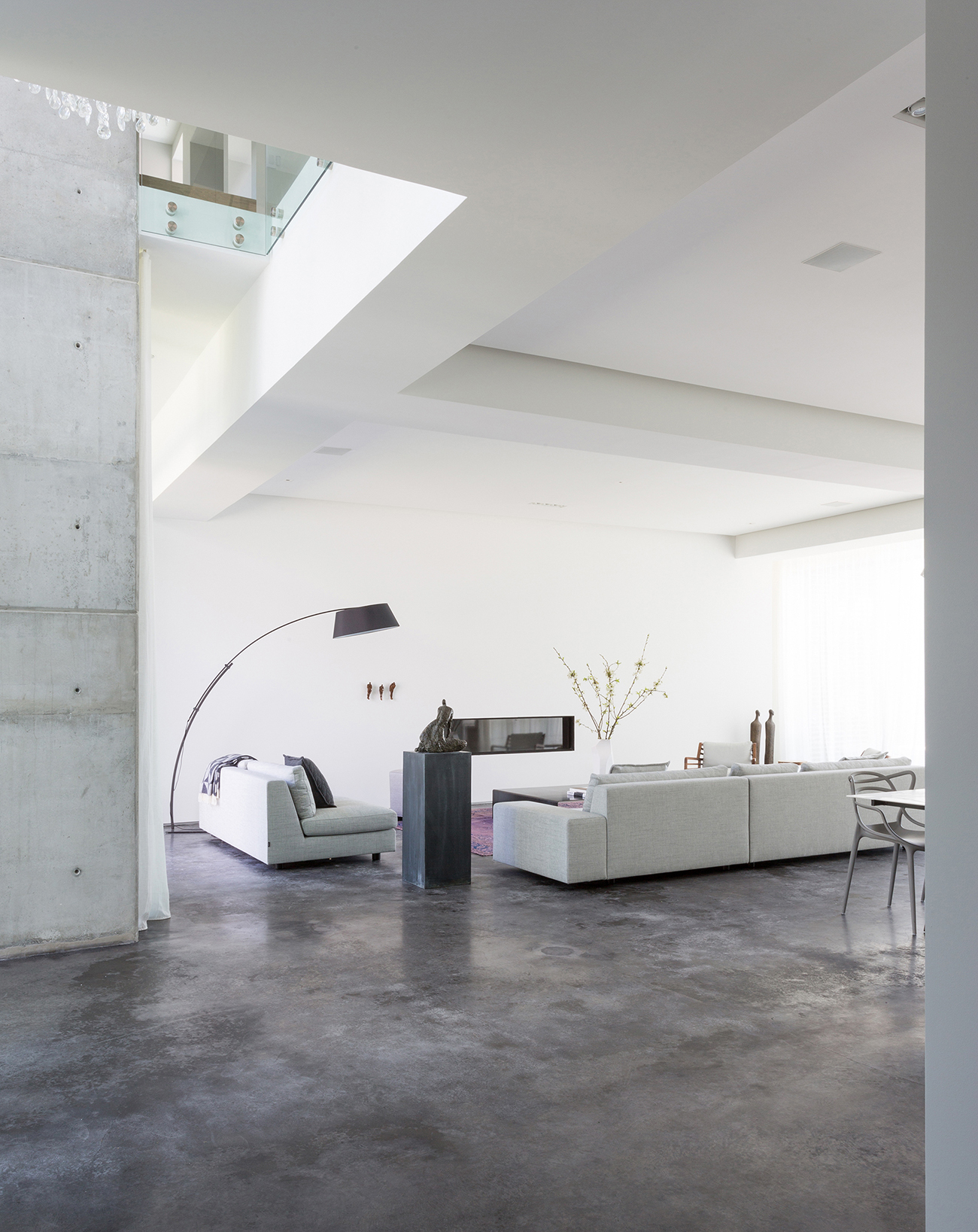 Living room with white coloured sofas