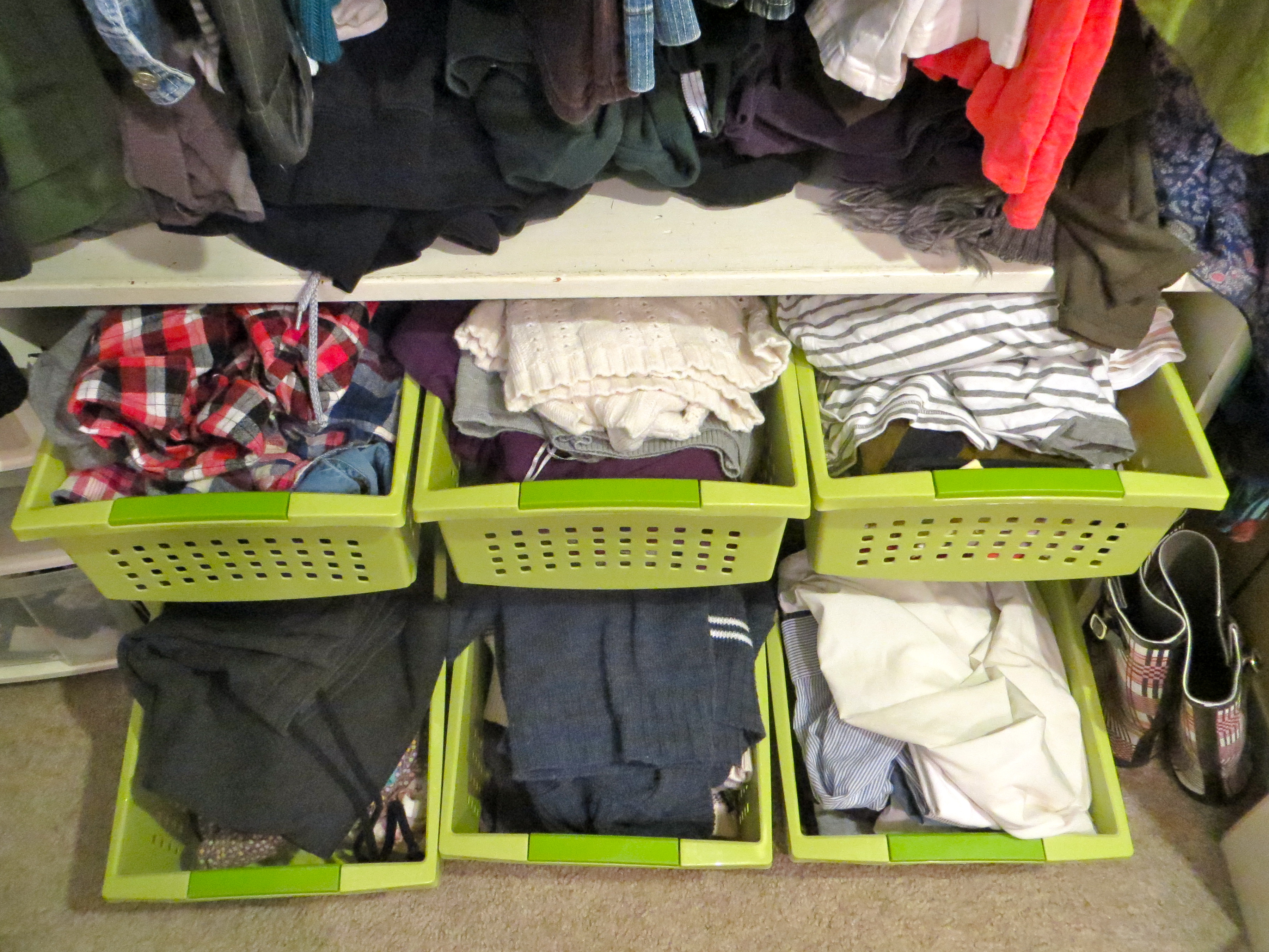 Add temporary bright drawers to the bottom of your wardrobe