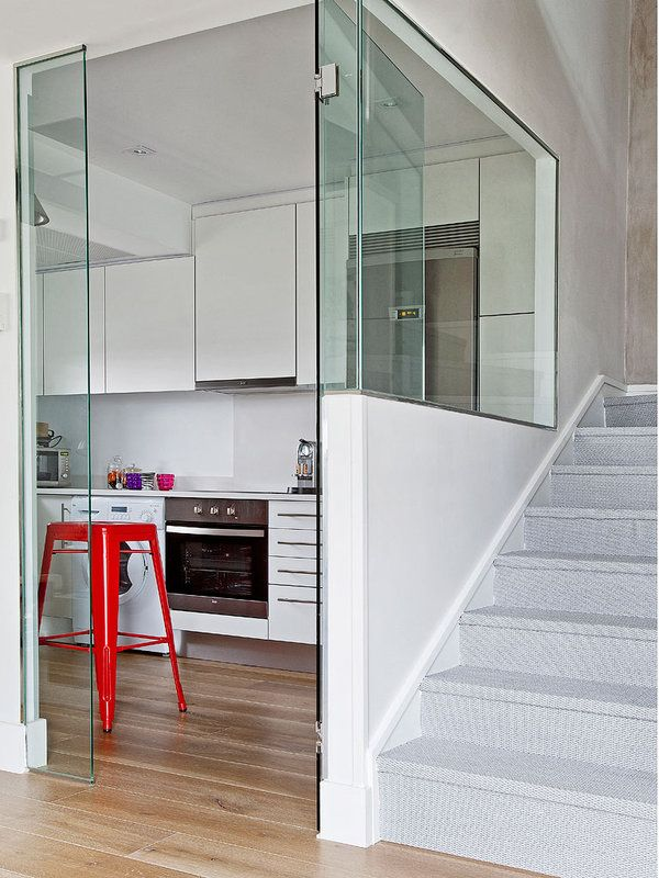 Glass door provides a barrier to sound and heat from the kitchen