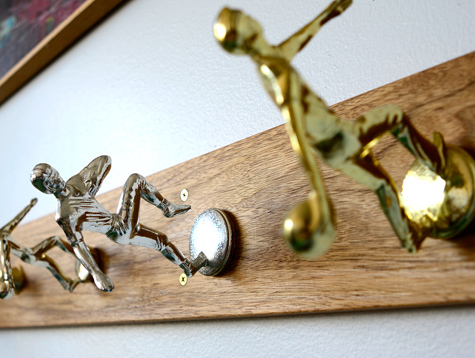 This coat rack uses figures taken from various athletic trophies