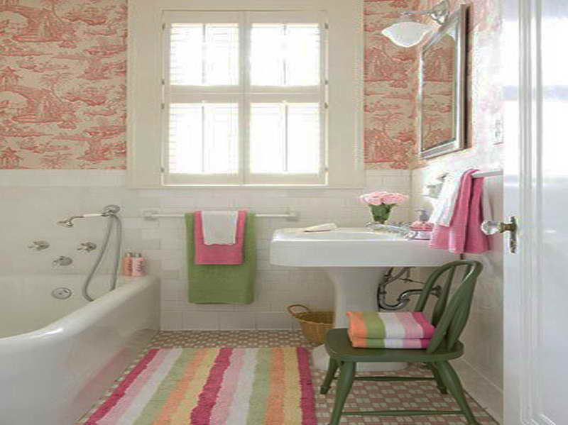 Bathroom with bright orange shower curtain and towel