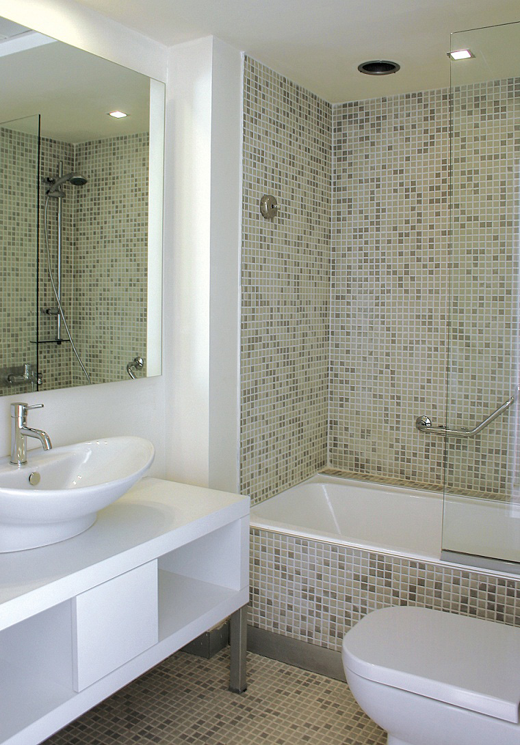Btahroom with green and gray designed tiles