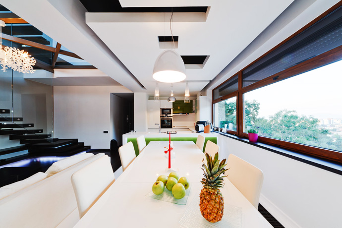 Dining area with white dining chairs and table