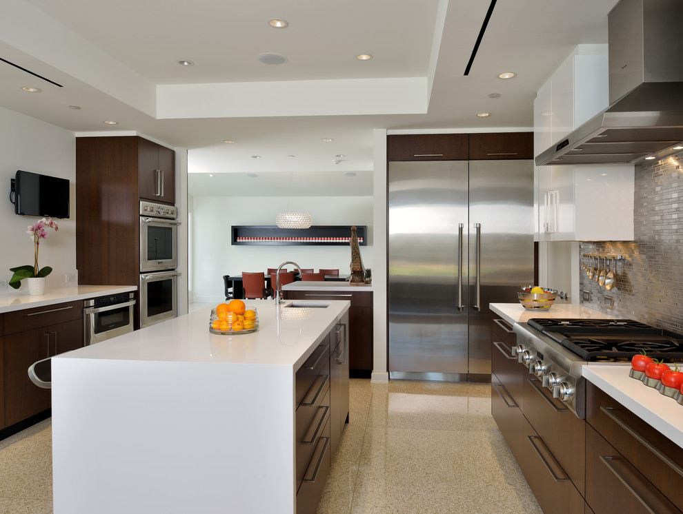 Kitchen island here doubles as a storage and sink area, and a breakfast bar