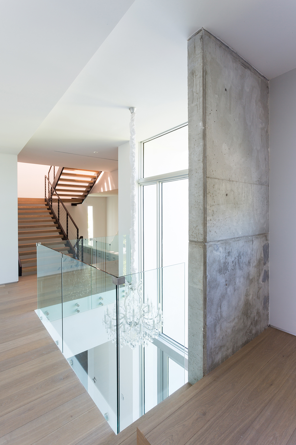 Overlooking the wooden floor is a glass fence