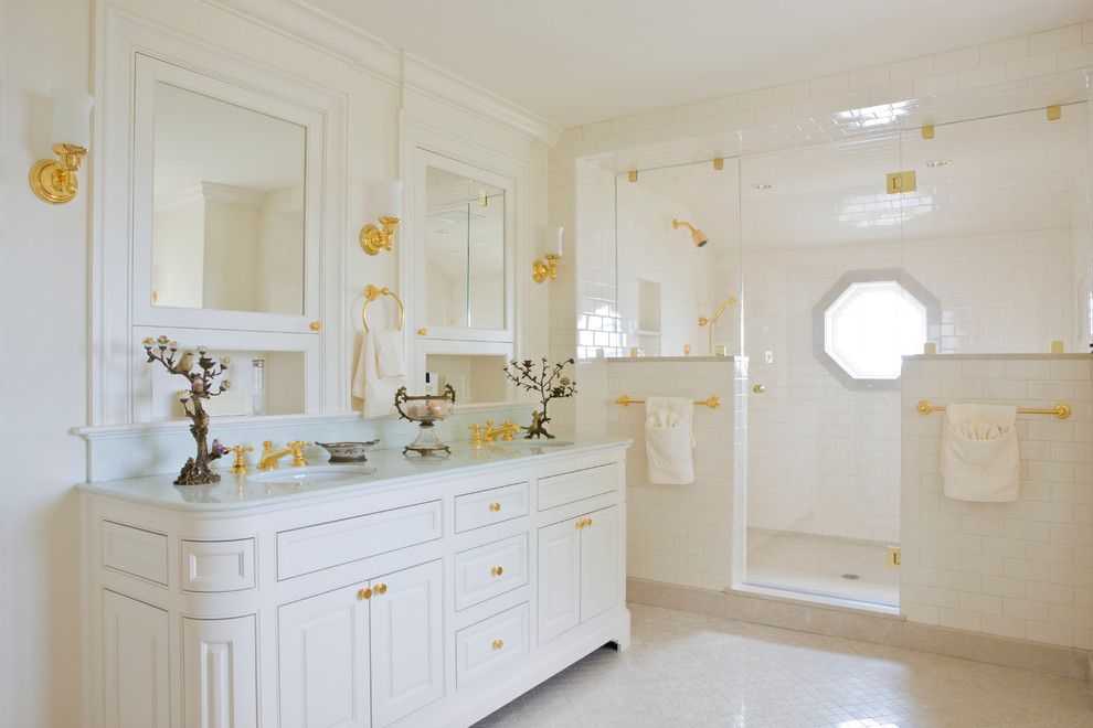 White bathroom with golden accent