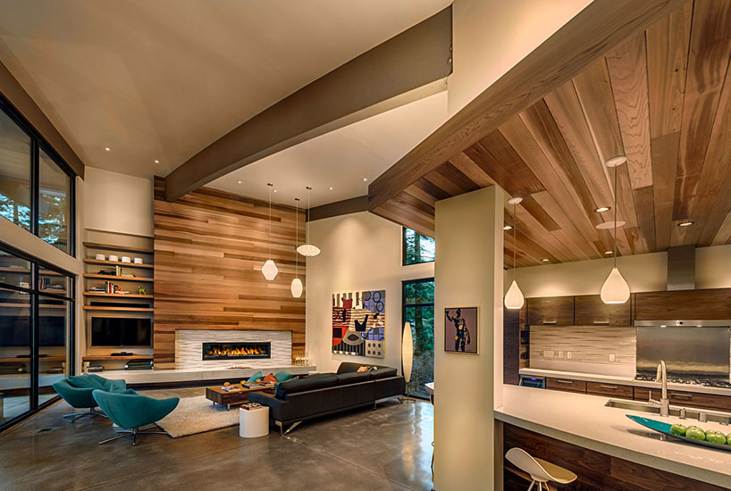 Rooms emit lot of warmth with a wooden wall and ceiling