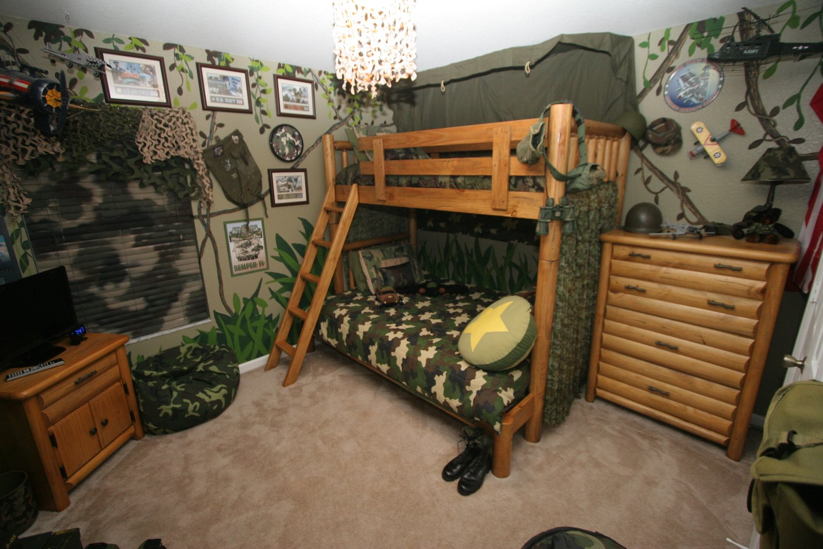 Green walls heightened the theme of military in this bedroom