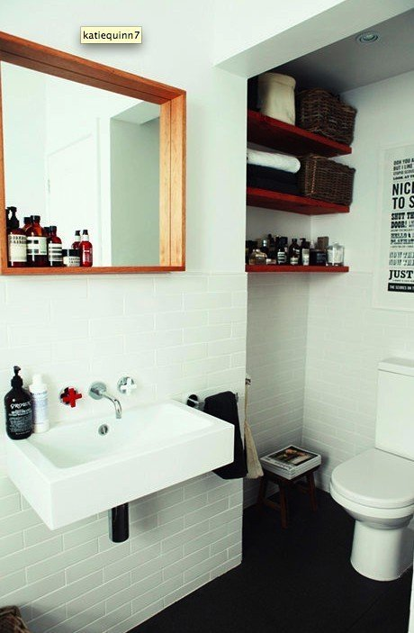 Bathroom with red floating shelves