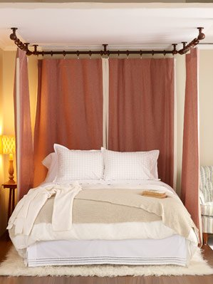Curtains served as the headboard for this bed