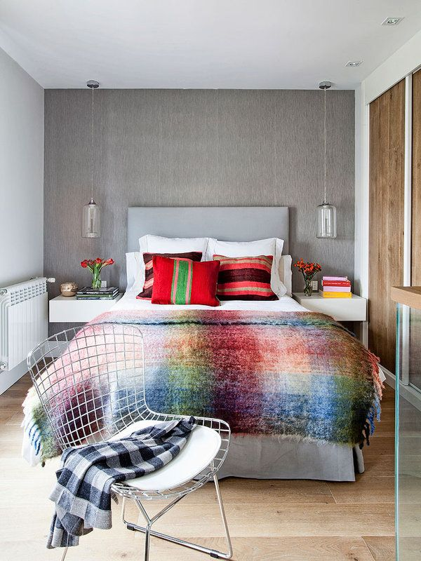 Soft multicoloured furnishings on a grey and simple backdrop