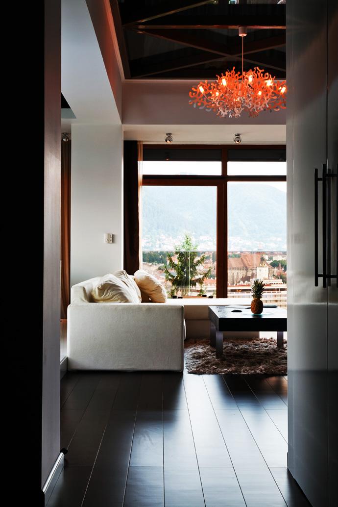 Teak flooring with the sofa area