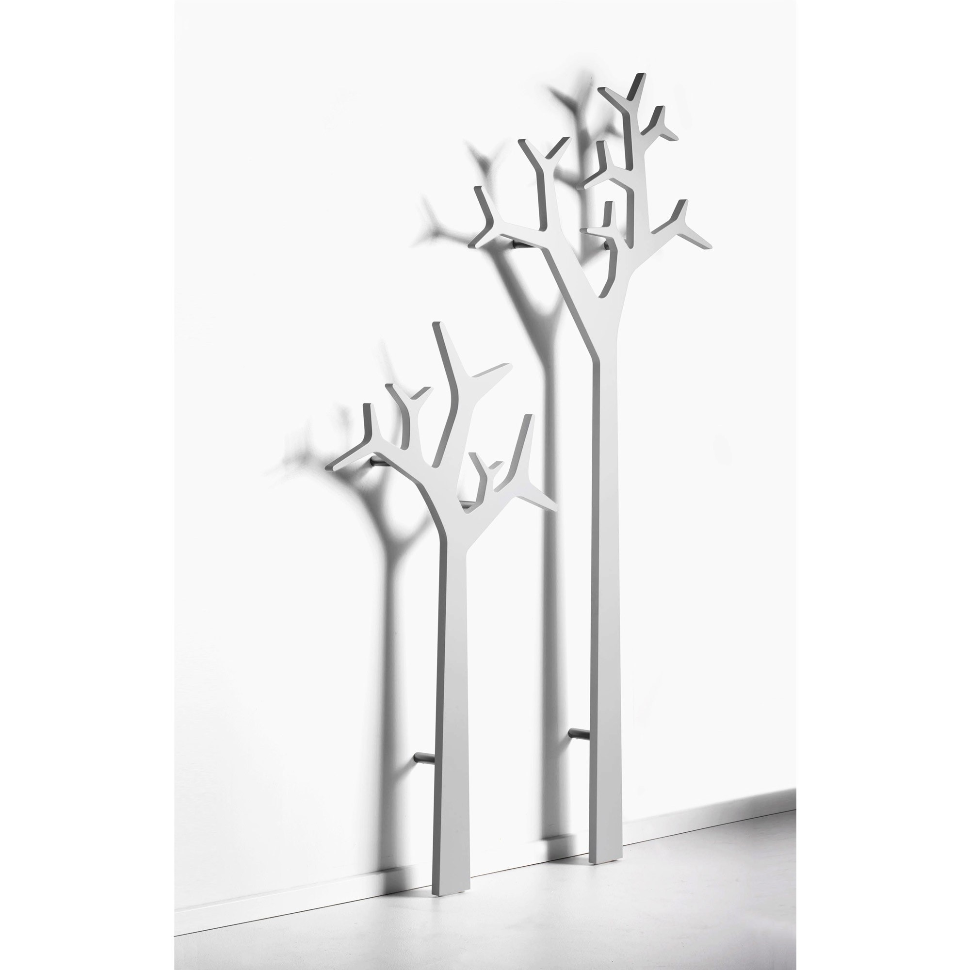 Tree coat stands can be attached to the walls