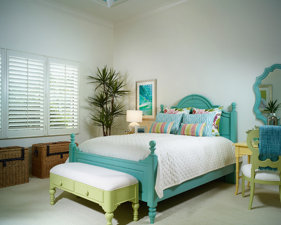 Turquoise stands out in this feminine bedroom