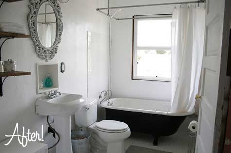 Bathroom with the black colored claw footed tub