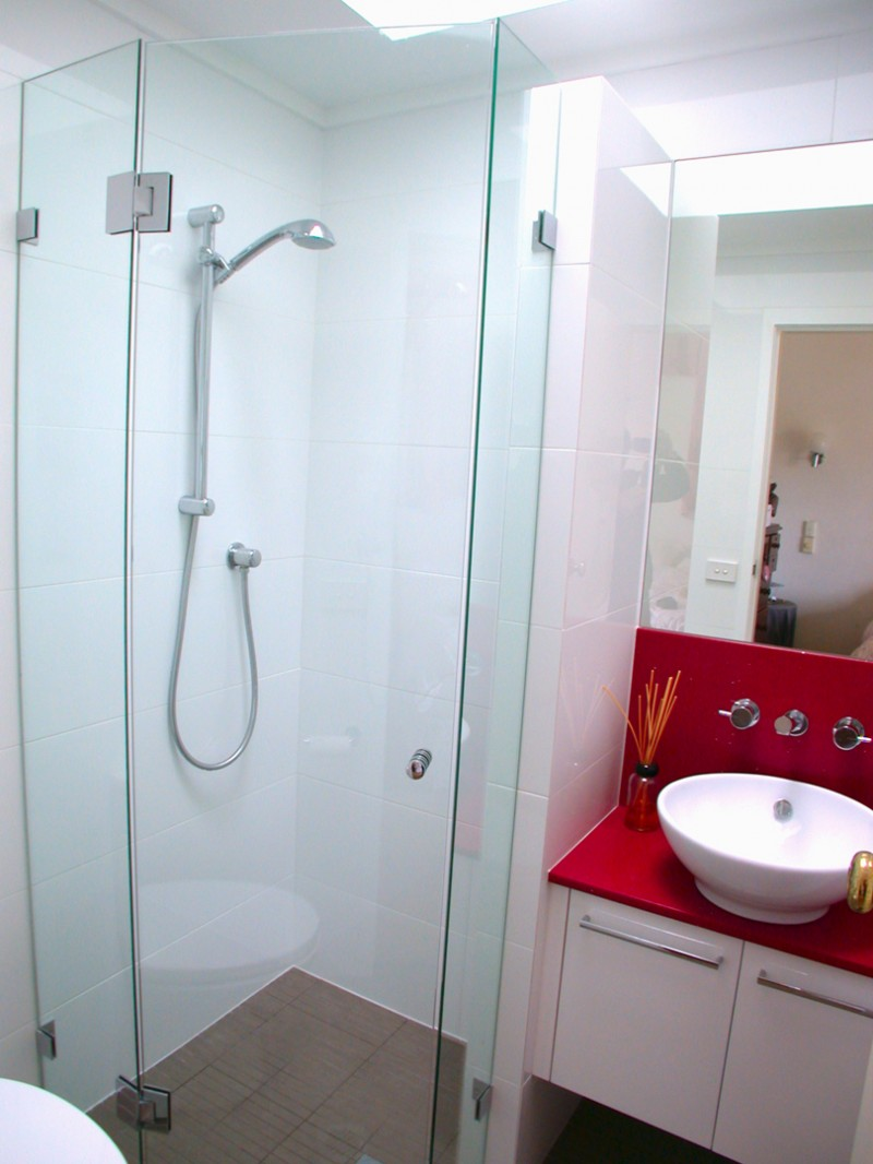 Bathroom with bright red color countertop