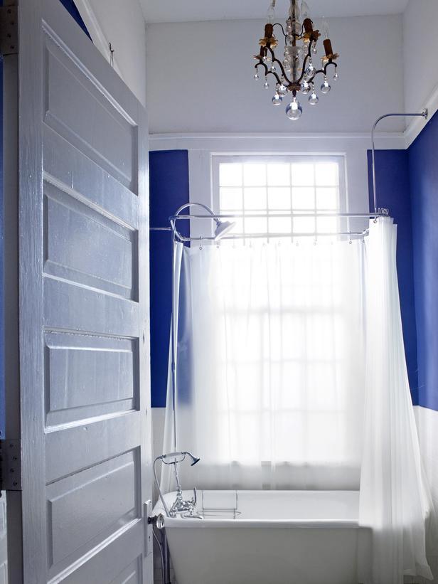 Bathroom with blue curtains