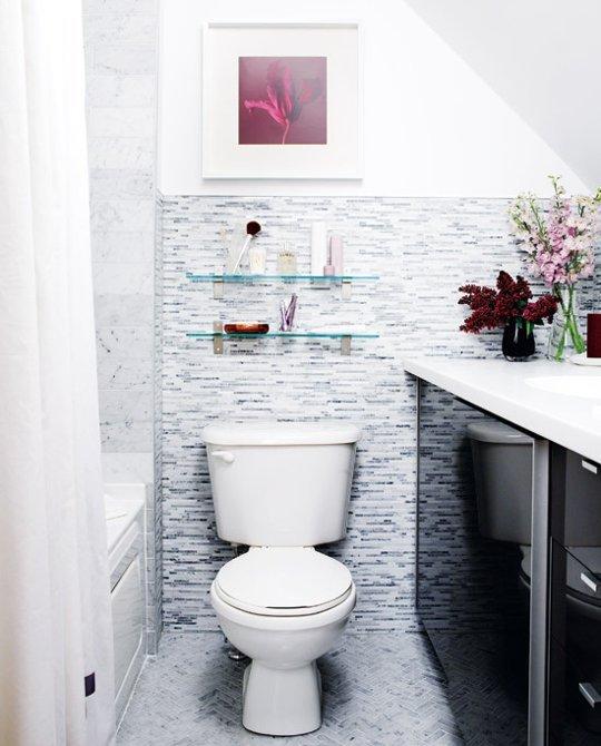 Bathroom with blue glass floating shelves