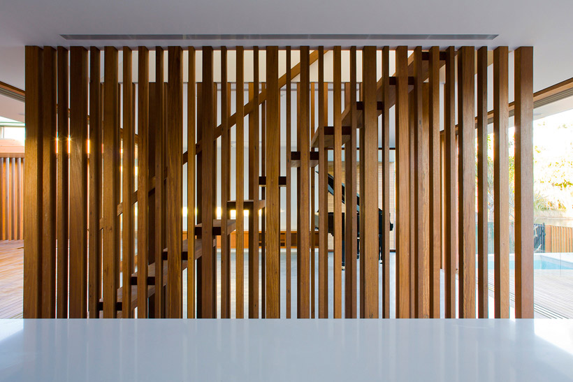 Floating steps are secured by pillars of wood of varying sizes