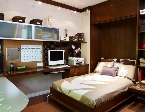 Brown colored walls matched the shiny wood floors and bed perfectly