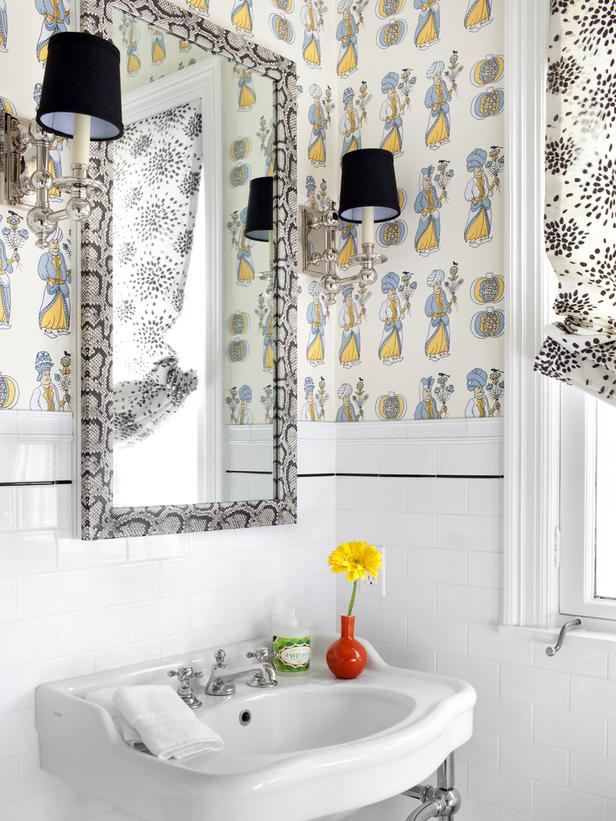 Bathroom with a multi colored wallpaper