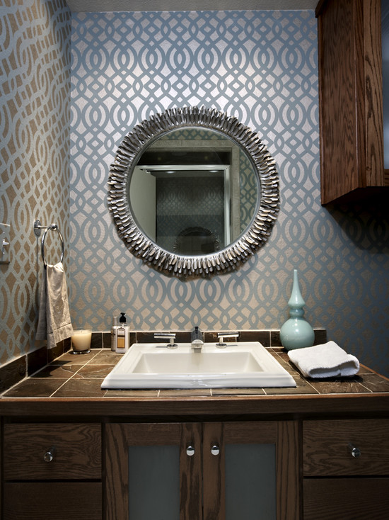 Bathroom with a metallic blue wallpaper