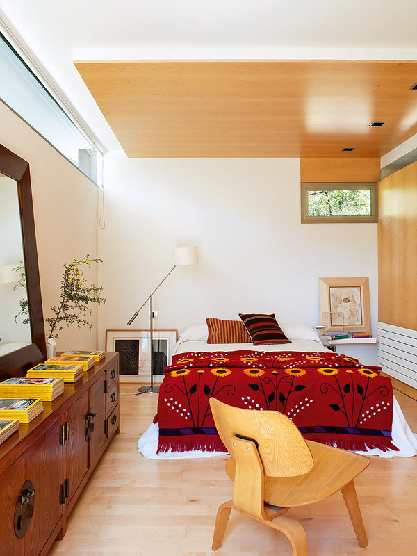 The red bedspread highlights the room