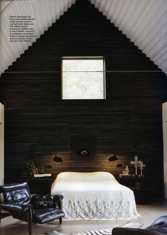 Bedroom with black upholstered chairs