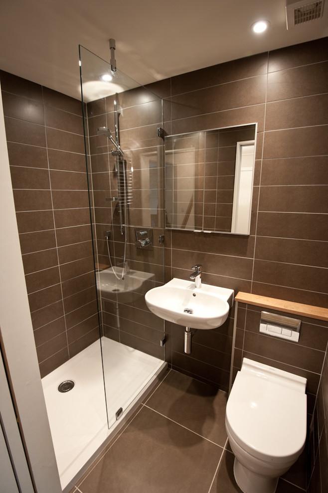 Bathroom with dark tiles