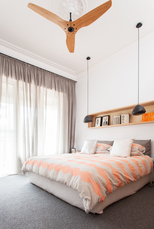 Bedroom with a striped bedcover