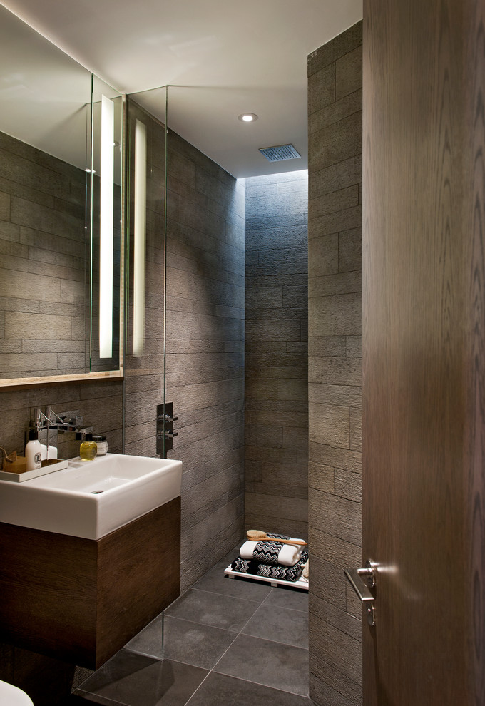 Dark bathroom with a white sink