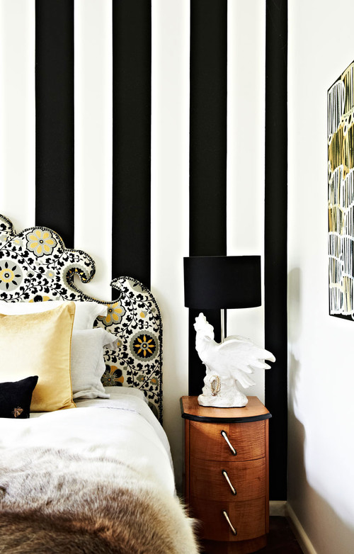 Bedroom with white and black striped wall