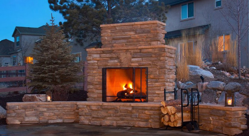 Outdoor stone fireplace with seating