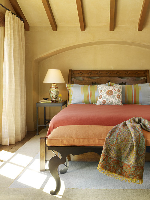 Bedroom with orange bedcover