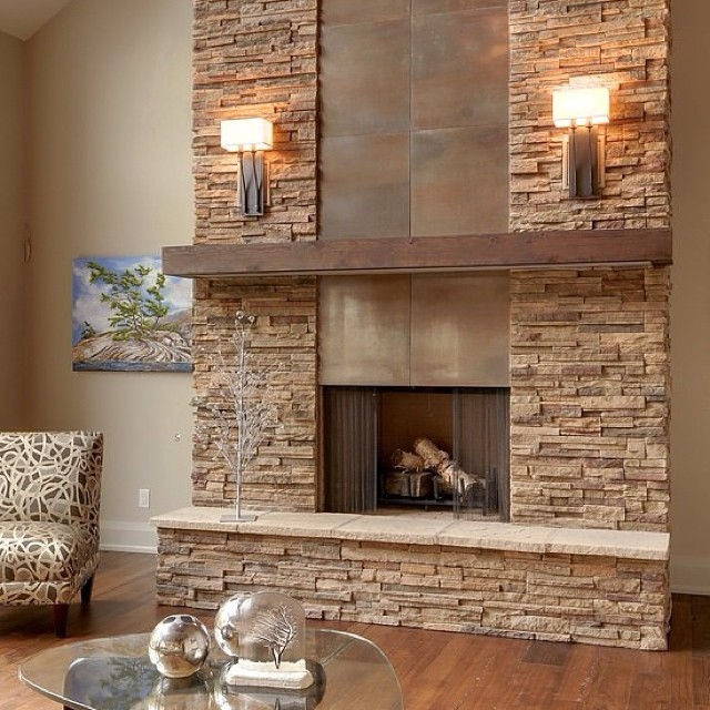 The chair match with the stonewall fireplace and wooden floors