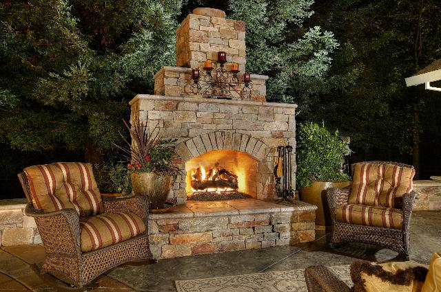 Outdoor stone fireplace with chairs
