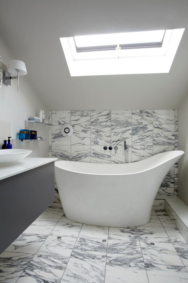 White bathroom with a white bathtub