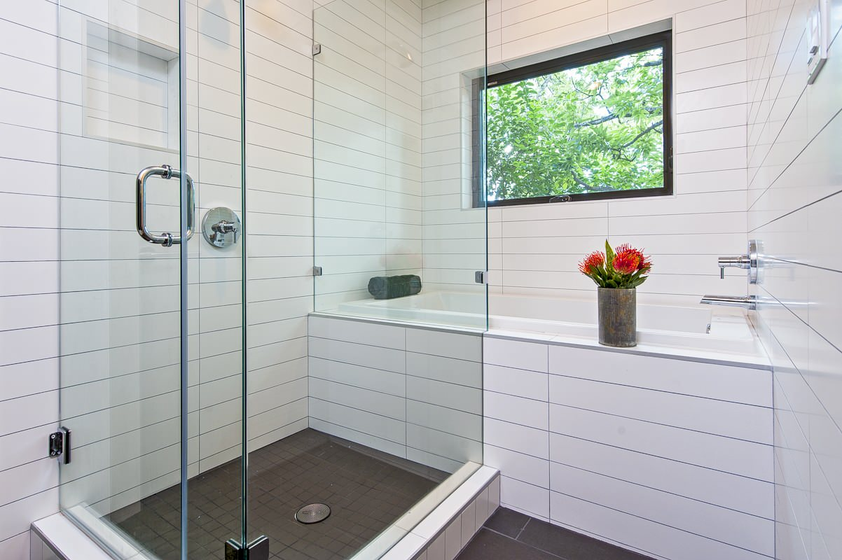 Bathroom with long glossy subway tiles