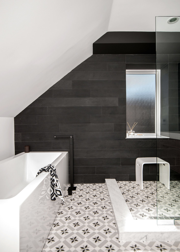 Bathroom with black wall tiles