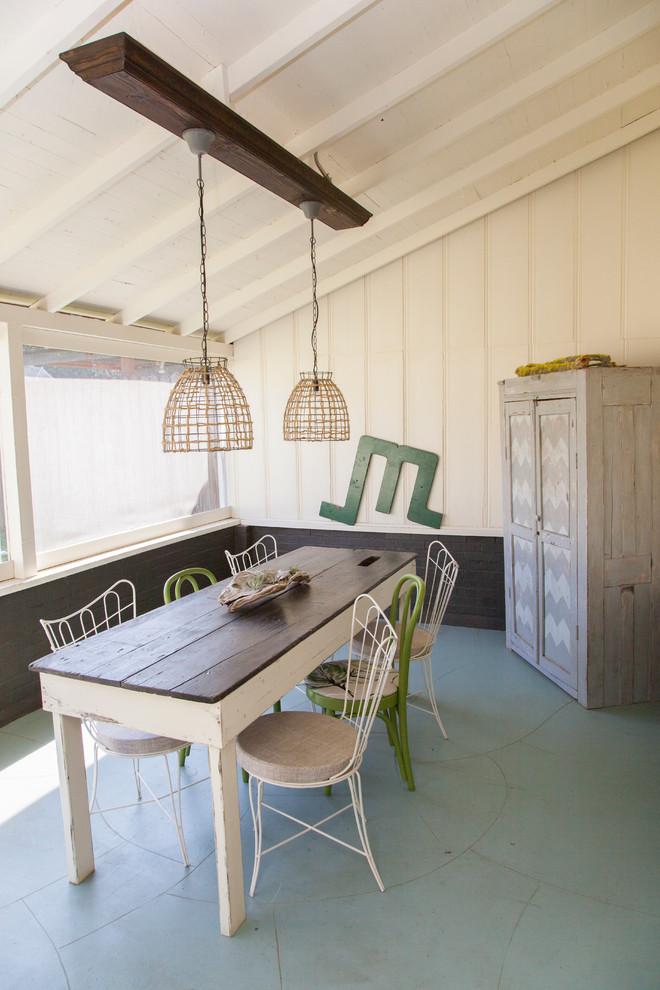 Dining table with green and white chairs besides