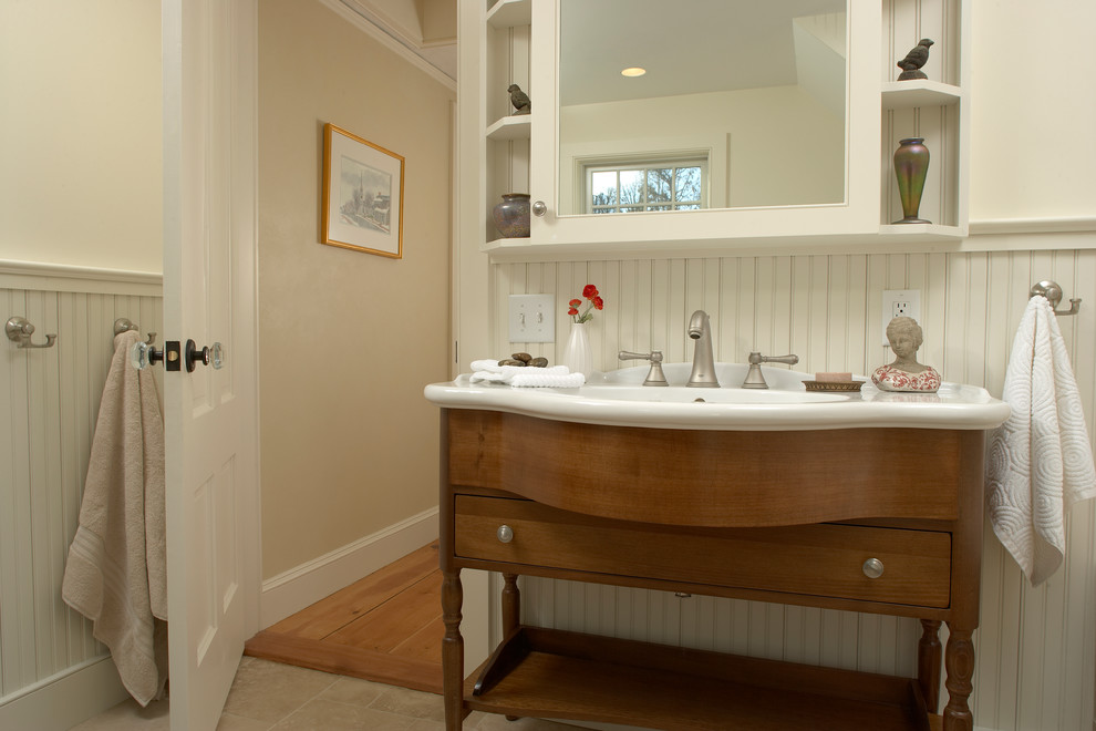 The vanity sink was highlighted by the white beadboard
