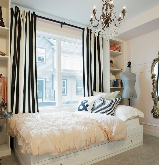 Bedroom with striped black and white curtain