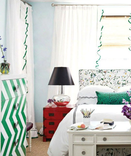 Bedroom with a green and white zizag cabinet
